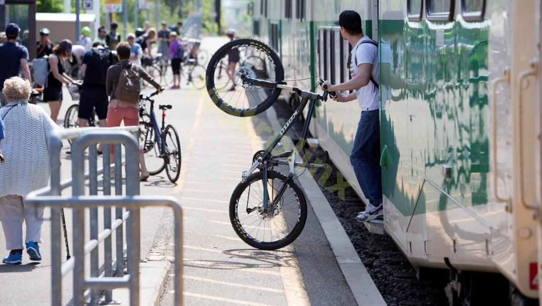 Passenger with bicycle disembarking