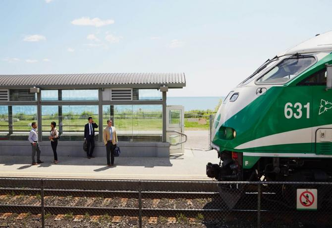 A GO train pulling into a station